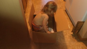 Getting in the box, with her baby!